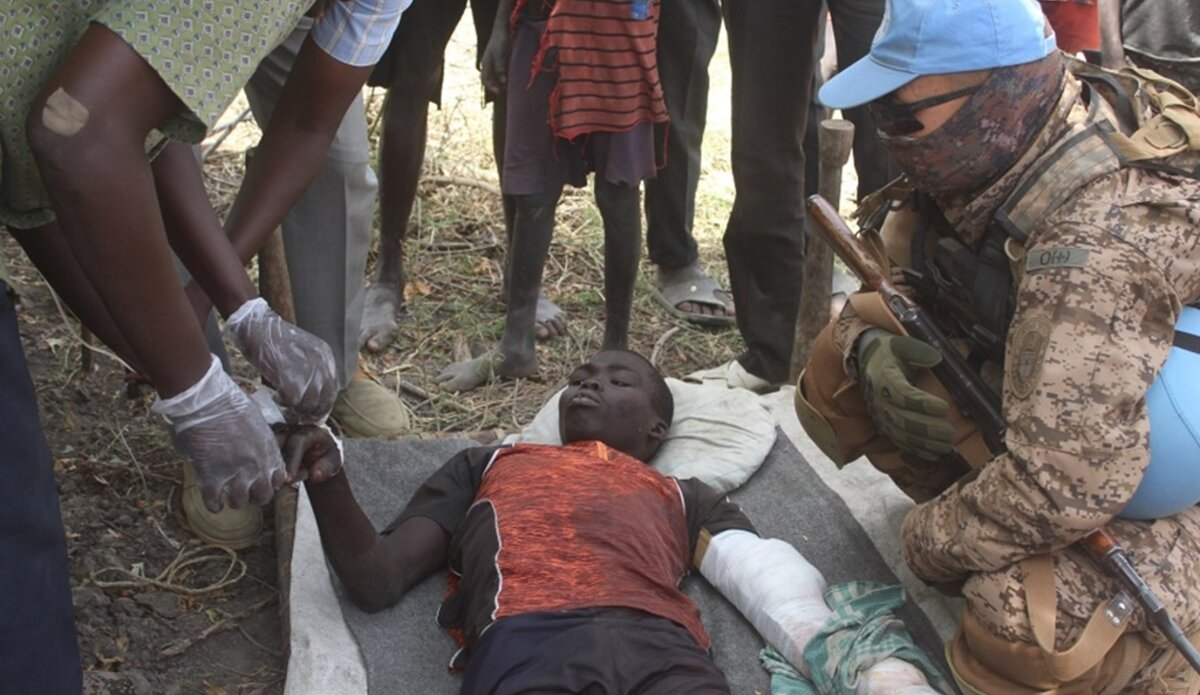 wounded civilian attended to