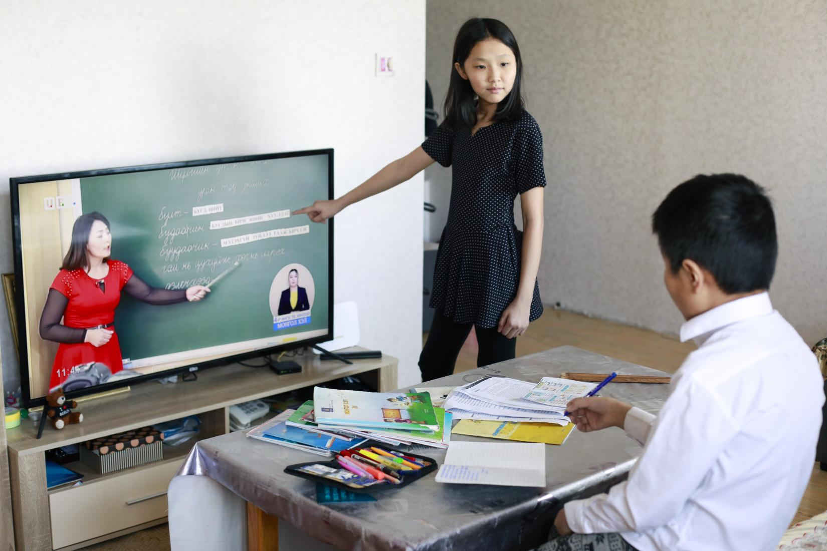 Children learning tele-lessons at home